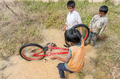 12,Dec,2016 -Some children from  Churu people play with their bycicle near by Dalat- Lam Dong- Vietnam. Some children from  Churu people play with their bycicle Royalty Free Stock Photography