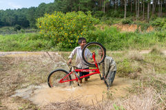 12,Dec,2016 -Some children from  Churu people play with their bycicle near by Dalat- Lam Dong- Vietnam. Some children from  Churu people play with their bycicle Royalty Free Stock Photos