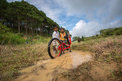 12,Dec,2016 -Some children from  Churu people play with their bycicle near by Dalat- Lam Dong- Vietnam. Some children from  Churu people play with their bycicle Stock Photo