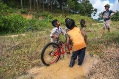 12,Dec,2016 -Some children  play with their bycicle near by Dalat- Lam Dong- Vietnam. Some children from  Churu people play with their bycicle near by Dalat- Lam Royalty Free Stock Image