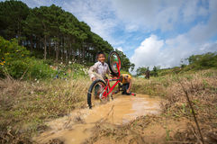 12,Dec,2016 -Some children  play with their bycicle near by Dalat- Lam Dong- Vietnam. Some children from  Churu people play with their bycicle near by Dalat- Lam Royalty Free Stock Photography