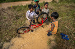 12,Dec,2016 -Some children  play with their bycicle near by Dalat- Lam Dong- Vietnam. Some children from  Churu people play with their bycicle near by Dalat- Lam Stock Photography