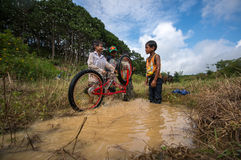 12,Dec,2016 -Some children  play with their bycicle near by Dalat- Lam Dong- Vietnam. Some children from  Churu people play with their bycicle near by Dalat- Lam Royalty Free Stock Photo