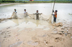 12,Dec,2016 -Some kids of Churu people drafting the fish near by Dalat- Lam Dong- Vietnam Stock Images