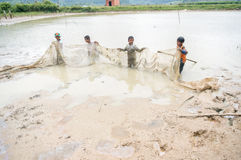 12,Dec,2016 -Some kids of Churu people drafting the fish near by Dalat- Lam Dong- Vietnam. Some kids of Churu people drafting the fish near by Dalat- Lam Dong Royalty Free Stock Image