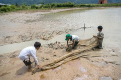 12,Dec,2016 -Some kids of Churu people drafting the fish near by Dalat- Lam Dong- Vietnam. Some kids of Churu people drafting the fish near by Dalat- Lam Dong Royalty Free Stock Photography