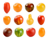 12 different sorts of tomatoes over white. High resolution image of 12 different sorts of small tomatoes on white background royalty free stock image