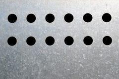 12 hål Arkivbild