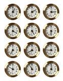 12 orologi che mostrano tempo differente Fotografie Stock Libere da Diritti