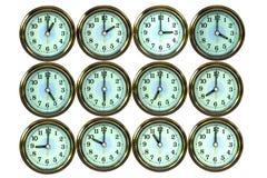 12 orologi di tempo dell'oro di colore, Fotografie Stock