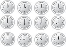 12 uur op de witte klokken royalty-vrije illustratie
