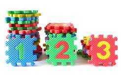 123 auf Puzzlespielmatte Stockbild