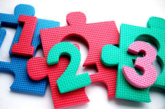 123 on puzzle mat. Colorful puzzle mat with colorful numbers Royalty Free Stock Images