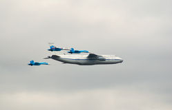 An-124 escorted by fighters Royalty Free Stock Photos