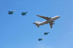 An-124 plane accompanied by group of Su-27 fighter Royalty Free Stock Photography