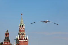 An-124 and Su-27 airplanes fly over Red Square Stock Images