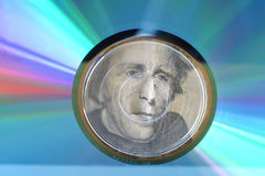 1299 CD cash investment. A studio still life of a colorful glowing compact disk & President Andrew Jacksons face layed under it close-up Stock Image