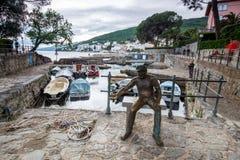 13 MAY 2019. Opatija, Croatia. Statue And Fishing Boat Dock Stock Photos