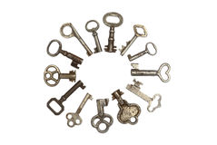 13 old skeleton keys in a circle isolated. 13 antique silver skeleton keys in a circle isolated stock images