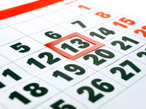 13th Friday. Friday 13th is framed on the calendar stock image