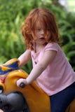 14逗人喜爱的女孩操场红头发人 库存图片