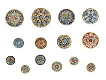 14 painted round wall-plates Stock Image