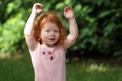 15逗人喜爱的女孩操场红头发人 图库摄影
