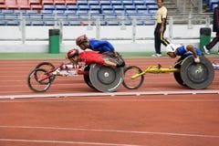 1500 mężczyzna metrów biegowy s wózek inwalidzki Fotografia Royalty Free