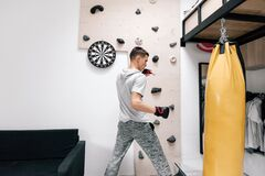 Free 16-17 Years Old Teenage Boy Workout With Boxing Bag In Home Gym Room Stock Photo - 171894450