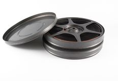 16 mm film canisters and reel. 16mm film canisters and reel Stock Photography