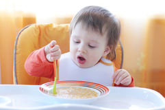 16 months baby eats stock photo