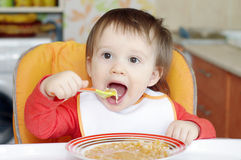 16 months baby eats soup Royalty Free Stock Photography