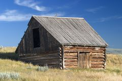 1700's style Norwegian barn in a field in Montana. A 1700's style Norwegian barn stand in a field on a ranch in Montana Royalty Free Stock Images