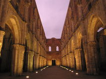 1786. San Galgano cathedral, church without roof in tuscany at the sunset Stock Image