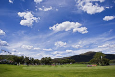 17th Green. Wide angle view of the 17th green. Good blue sky with lots of white puffy clouds Stock Images