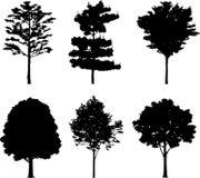 18 isolerade silhouettestrees Royaltyfri Bild