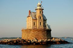1878 Race Rock Lighthouse. Gothic-revival styled 1878 Race Rock Lighthouse sits on a round stone base atop a man-made rocky island in New York State's Long Royalty Free Stock Images