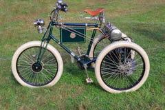 1899 antika trehjuling   Arkivbilder