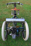 Antique Tricycle. 1899 Antique Tricycle by DeDion Bouton displayed royalty free stock images