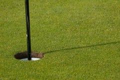 18th hole. Hole and flag on a golfing green stock photos