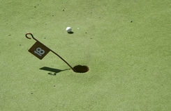18th Hole. Mini Golf green with 18th hole and small flag Stock Images