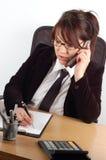19名女实业家服务台 免版税库存图片