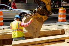 Free 19 APRYL 2019 NY. USA Workers On A Road Construction, Excavation In The City For Layng Of A High-power Cable Stock Image - 145408781