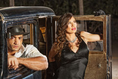 1920s Gangster Driver and Woman Royalty Free Stock Photos