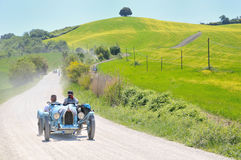 A 1925 BUGATTI Type 35 A at 1000 Miglia. Buonconvento (Siena), ITALY - MAY 14 : A 1925 built light blue BUGATTI Type 35 A driven by Giuseppe Brevini during a Stock Images