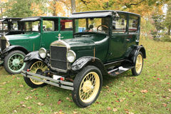 1927 Model T Ford Two Door Sedan. A 1927 Model T Ford two-door sedan.  1920's passenger car for four people.  Painted correct dark green with black fenders.  The Stock Photos