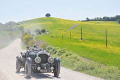 A 1930 Bentley 4 Litre Supercharged at 1000 Miglia. Buonconvento (Siena), ITALY - MAY 14: A 1930 built black Bentley 4� Litre Supercharged driven by Geoffrey Royalty Free Stock Photo