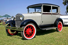 1930 Model A Ford Sedan. Grey and black.  Red wire spoked wheels Royalty Free Stock Image