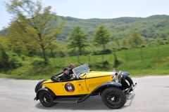 A 1930 yellow Bugatti type 40A at 1000 Miglia. Pieve Santo Stefano (AR), ITALY - MAY 13 : A 1930 built yellow Bugatti type 40A driven by Ivano Frascari and Royalty Free Stock Images