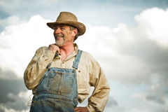 1930s farmer smiling. With beautiful sunlight Royalty Free Stock Photo